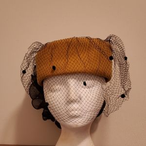 Sonni California tulle hat with large bow accent